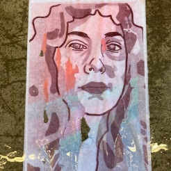 Two page print of Laura DeVito degraded by water