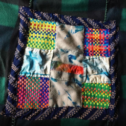 Quilt with hand-woven and hand-dyed elements