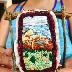 Embroidery of Colorado mountains with stick frame